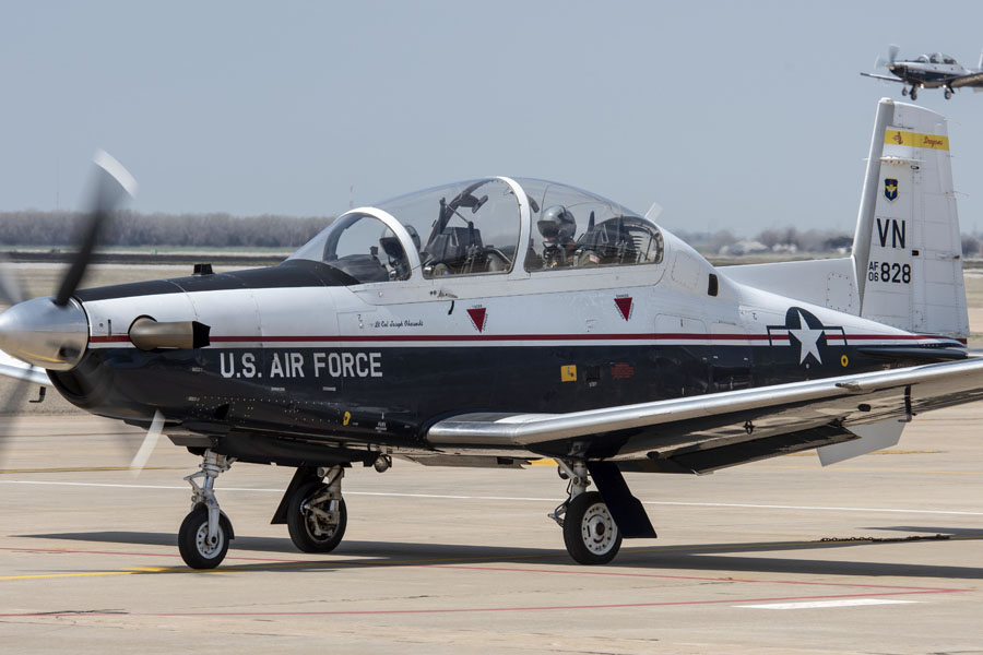 A T-6 Texan II takes off from the flightline at Vance Air Force Base on Mar. 27, 2019. The T-6A Texan II is a single-engine, two-seat primary trainer designed to train undergraduate pilot training students. (U.S. Air Force Photo by Airman 1st Class Octavius Thompson)